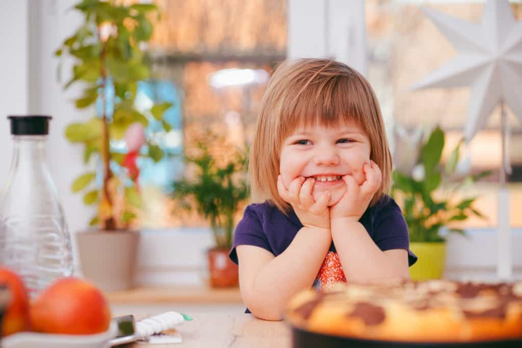 smiling toddler ready for a healthy snack