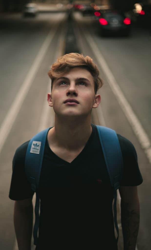 Teen boy looking up.